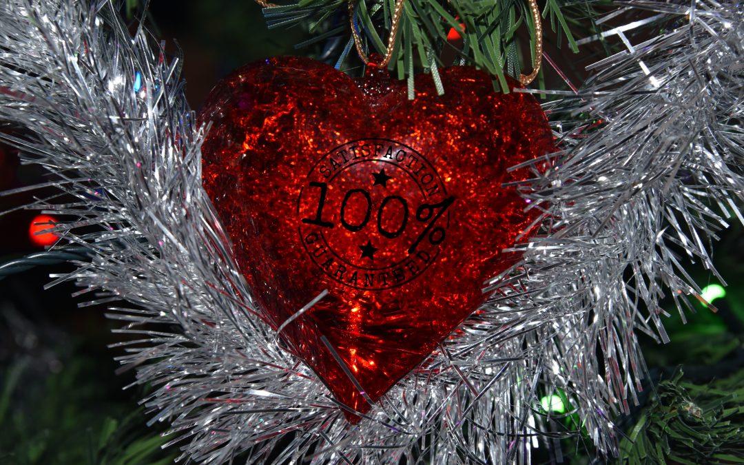 Un cuore con il timbro di garanzia per indicare un amore sicuro